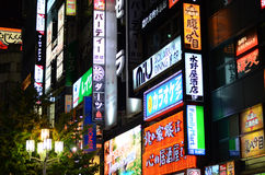 Tokyo, Japan - November 23, 2013: Neon lights in Shinjuku distri Stock Image