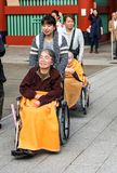 TOKYO, JAPAN - NOVEMBER 7, 2017: Older women in wheelchairs on a stock images