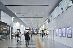 Tokyo, Japan:November 5,2014- Crowd of people wakling inside the JR train station building stock photography