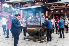 TOKYO, JAPAN - 2014 November 5 : People pray at Senso-ji Temple Stock Photo