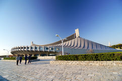 Tokyo, Japan - November 20, 2013: People visit Yoyogi National Gymnasium in Tokyo. Royalty Free Stock Photo