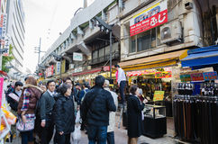 Tokyo, Japan- November 22, 2013: Shoppers visit Ameyoko market Royalty Free Stock Photography