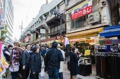 Tokyo, Japan- November 22, 2013: Shoppers visit Ameyoko market Royalty Free Stock Photography