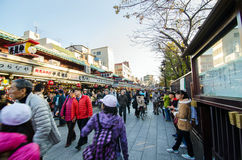 Tokyo, Japan - November 21, 2013: Tourists visit Nakamise shopping street in Asakusa Stock Photo