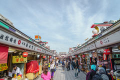 TOKYO,JAPAN - 24 November  2015 :Tourists walk on Nakamise Dori. In Sensoji shrine.Sensoji temple with a variety of traditional, local snacks and tourist Stock Photography