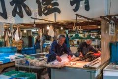 TOKYO, JAPAN - November, 22, 2014: Tuna sellers at Tsukiji Stock Images