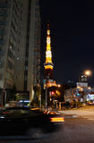 Tokyo, Japan - November 28, 2013: View of busy street at night with Tokyo tower Stock Photos