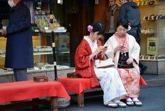 TOKYO, JAPAN - NOVEMBER 21, 2013: Young Japanese women wearing a Stock Photography