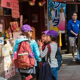 TOKYO, JAPAN - OCTOBER 31, 2017: Children on a city street. Close-up. TOKYO, JAPAN - OCTOBER 31, 2017: Children on a city street. Close-up royalty free stock photo