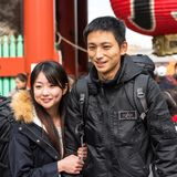 TOKYO, JAPAN - OCTOBER 31, 2017: Couple of tourists on a city street. Close-up. royalty free stock photo