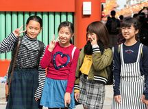 TOKYO, JAPAN - OCTOBER 31, 2017: Group of children on a city street. Close-up. TOKYO, JAPAN - OCTOBER 31, 2017: Group of children on a city street. Close-up royalty free stock photography