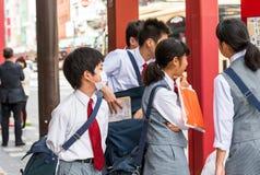 TOKYO, JAPAN - OCTOBER 31, 2017: Japanese school children on a city street. Close-up. TOKYO, JAPAN - OCTOBER 31, 2017: Japanese school children on a city street stock photo