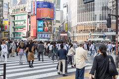 Tokyo, Japan - October 22, 2015 : Pedestrians cross at Shibuya C Royalty Free Stock Photo