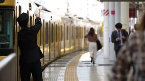 Tokyo, Japan - October 30, 2019: People are running to Seibu Line Train in Seibu Shinjuku Station, Tokyo, Japan. Train is waiting. People are running to Seibu stock video