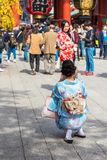 TOKYO, JAPAN - OCTOBER 31, 2017: Two girls in a kimono by the temple Senso-ji. Vertical. Copy space for text. TOKYO, JAPAN - OCTOBER 31, 2017: Two girls in a Stock Images