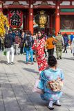 TOKYO, JAPAN - OCTOBER 31, 2017: Two girls in a kimono by the temple Senso-ji. Vertical. Copy space for text. TOKYO, JAPAN - OCTOBER 31, 2017: Two girls in a Stock Photography