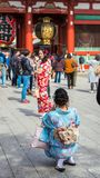 TOKYO, JAPAN - OCTOBER 31, 2017: Two girls in a kimono by the temple Senso-ji. Vertical. Copy space for text. TOKYO, JAPAN - OCTOBER 31, 2017: Two girls in a Royalty Free Stock Images