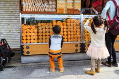 Unidentified children choosing snack at Nakamise Dori the shopping area of Sensoji temple the fam Royalty Free Stock Photography