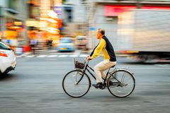 Unidentified old man riding bicycle at Ameya Yokocho the famous shopping area of Ueno District, Tokyo. Stock Photography