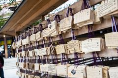 Tokyo, Japan - 13 October, 2017: Wooden blessing Plates in Meiji Jingu Shrine, . It is the traditional way to send a prayer to the. Gods royalty free stock image