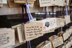 Tokyo, Japan - 13 October, 2017: Wooden blessing Plates in Meiji Jingu Shrine, . It is the traditional way to send a prayer to the. Gods stock image