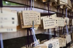 Tokyo, Japan - 13 October, 2017: Wooden blessing Plates in Meiji Jingu Shrine, . It is the traditional way to send a prayer to the. Gods stock photo
