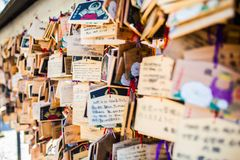 Tokyo, Japan - 13 October, 2017: Wooden blessing Plates in Meiji Jingu Shrine, . It is the traditional way to send a prayer to the. Gods royalty free stock photo