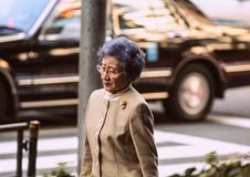 And old woman in the Tokyo. Japanese people walking on the street. stock photography