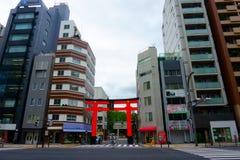 Shitaya Shrine. Red Torii and high-rise buildings. TOKYO, Japan - Sept 11 2018: Shitaya Shrine. Red Torii and high-rise buildings. Located close to the Inaricho stock photography