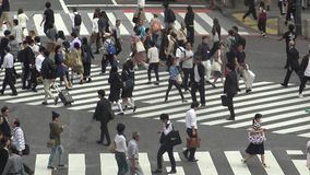 Aerial view of crowd of pedestrian crossing in Shibuya intersection Tokyo.