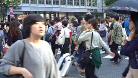 4K Travelling of crowd asian pedestrian crossing Shibuya intersection Tokyo stock video footage