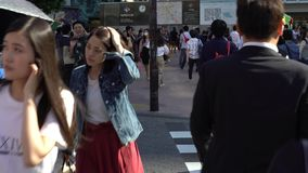 4K Moving dolly of crowd pedestrian crossing Shibuya intersection Tokyo. stock video footage
