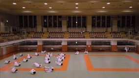 Video of a martial art training of Judo in the dojo of the Kodokan Judo Institute of Tokyo famous for its founder Kano Jigoro. Tokyo, Japan - September 17 2019 stock footage