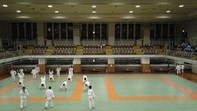 Video of a martial art training of Judo in the dojo of the Kodokan Judo Institute of Tokyo. Tokyo, Japan - September 20 2019: Video of a martial art training of stock footage