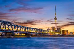 Tokyo, Japan River Skyline. Tokyo, Japan skyline and bridge on the Arakawa River Stock Image