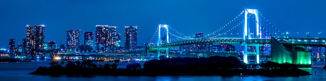 Tokyo, Japan skyline with Rainbow Bridge at night royalty free stock images
