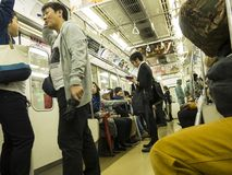 Tokyo japan, Subway Train, Travel, Commuters, People. People in Tokyo, Japan ride the subway metro train system. Asia and the orient are popular travel Stock Photography