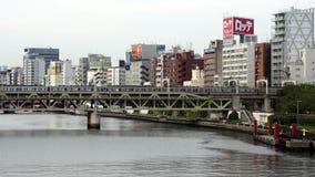 Tokyo Japan. Time Lapse of Passenger Train Passing the Tokyo Skyline Daytime - Tokyo Japan stock video