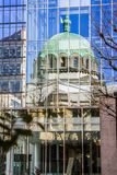 Window reflection of the dome of church. Modern architecture of the Tokyo. 2013.01.07, Tokyo, Japan. Window reflection of the dome of church. Modern royalty free stock images