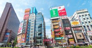 TOKYO - JUNE 1, 2016: Buildings and ads of Shinkuku near railway Stock Image