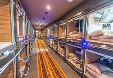 TOKYO - JUNE 1, 2016: Interior of capsule hotel in city center. Royalty Free Stock Image