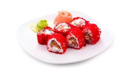 Tokyo maki. Image of Tokyo maki sushi rolls in red caviar served with pickled ginger and wasabi royalty free stock photography