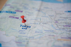 Tokyo map and push pin marking on a tourist royalty free stock photo