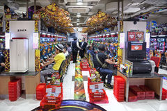 TOKYO - MAY 16, 2016: Two rows of japanese slot machines in the unidentified Pachinko parlor Tokyo, Japan. TOKYO - MAY 16, 2016: Two rows of japanese slot Royalty Free Stock Image