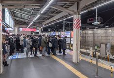 TOKYO, JAPAN - FEBRUARY 5, 2019: Tokyo Metro Stop with Many People. Their Are Waiting Train stock images