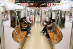 Tokyo metro train. TOKYO, JAPAN - DECEMBER 3, 2016: Passengers ride a metro train in Tokyo. With more than 3.1 billion annual passenger rides, Tokyo subway Stock Images