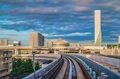 Tokyo monorail transportation system line in Odaiba. With Rainbow bridge on background Stock Photos