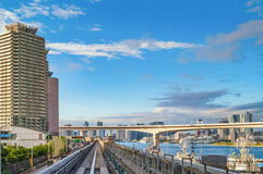 Tokyo monorail transportation system line in Odaiba. With Rainbow bridge on background Royalty Free Stock Images
