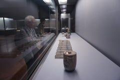 Tokyo national museum. Elderly man looks at antique porcelain stock photos
