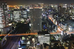 Tokyo at night. Tokyo streets, tracks and skyscrapers at night from high above stock image